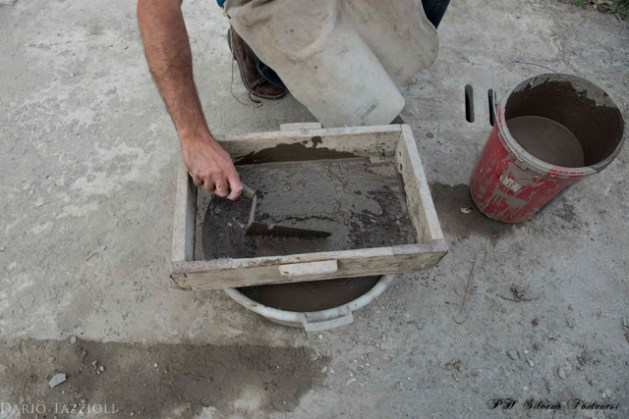 10. Refining the clay with a sieve. jpg