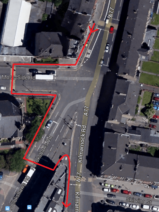 The 'high street' is labelled as the A77. The line in red is the route that a pedestrian on the pavement has to follow on the western side, including two pedestrian crossings.