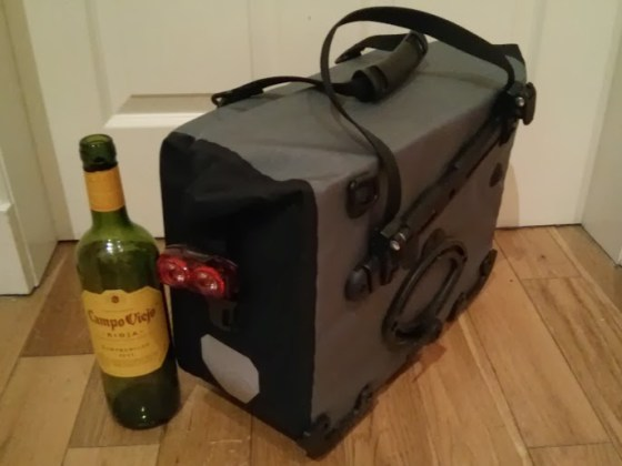 The QR2 system, along with a rear light attached to the buckle strap, a big white reflector, and the mysterious wine bottle.