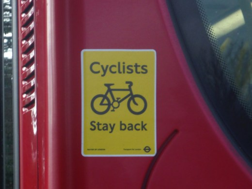 Cyclists Stay back sticker on a bus