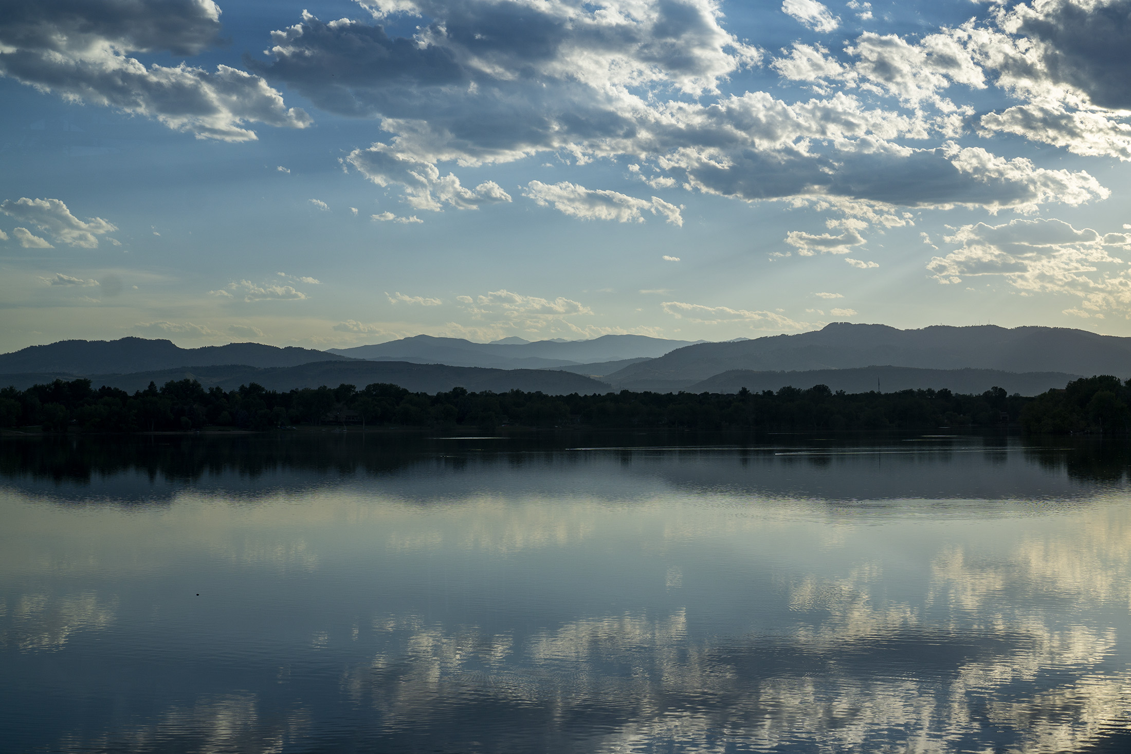 View toward Horsetooth Rock across a lake in early evening, Fort Collins, Colorado / Darker than Green
