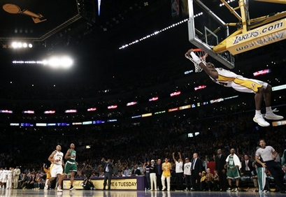After stealing the ball in the final minutes against the Boston Celtics, Los Angeles Lakers guard Kobe Bryant dunks the ball in Game 5 of the NBA basketball finals Sunday, June 15, 2008, in Los Angeles. The Lakers won 103-98.
