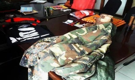 Ten terror suspects were found in possession of weapons, military uniforms and a black flag at a mosque earlier this week. Photo: Police Handout