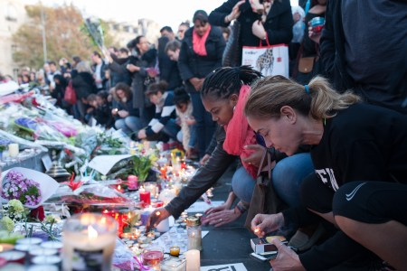 People gather at a memorial in Paris. A vigil will be held at the French Embassy in Dar on Tuesday, November 17 at 18:30. Photo: Flickr user did.van