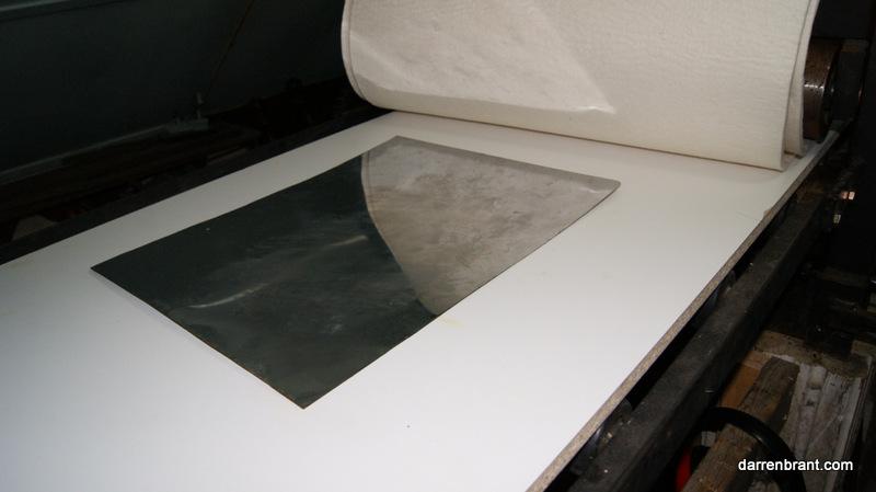 Printing press bed