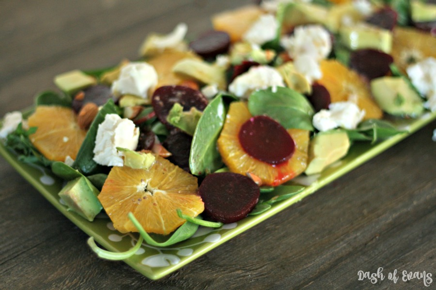 Light and fresh salad for winter--or any season! Fresh orange slices, avocado, beets and goat cheese with a light honey mustard vinagarette! YUM! | @DashOfEvans