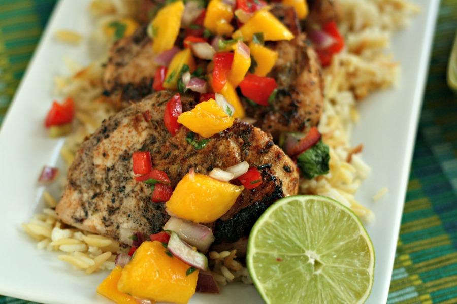 Make tonight an island party! Jerk Pork Chops with Mango Salsa is grilled up in less than 30 minutes. YUM! via @DashOfEvans #GrillPorkLikeASteak (ad)