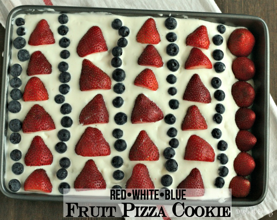 Looking for a simple patriotic dessert? Here ya go: Fruit Pizza Cookie! Sugar cookie dough with orange zest, whipped vanilla frosting and berries! Oh my YUM! #SundaySupper