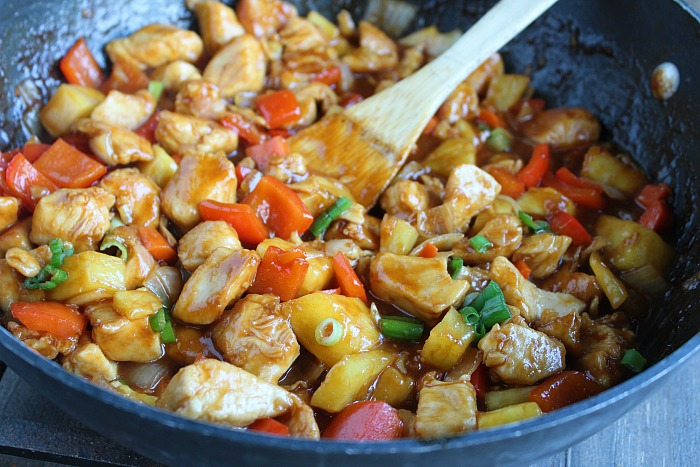 Sweet & Sour Chicken...YUM! Faster AND cheaper than takeout! Using Kikkoman sauce, fresh veggies and pineapple, plus boneless chicken breasts. Delicious and easy for any day of the week. via @DashOfEvans