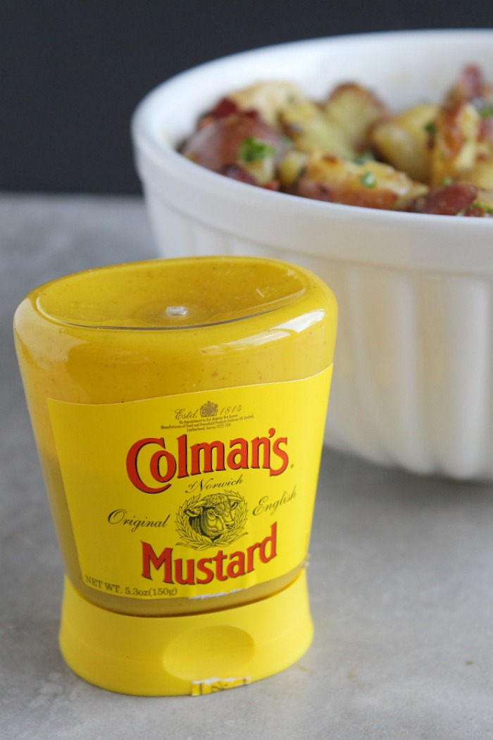 This warm potato salad is sure to be a hit at your next cookout! Plus, the combo of bacon and a tangy Colman's mustard dressing can't be beat! via @DashofEvans #HotMessAround (ad)
