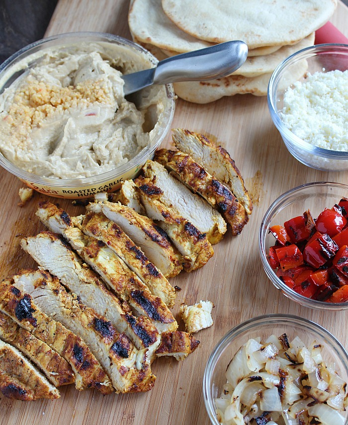 Celebrate grilling season with a delicious and healthy appetizer! On a grilled naan, add Sabra hummus, grilled chicken and veggies and top with feta cheese. YUM! via @DashOFEvans