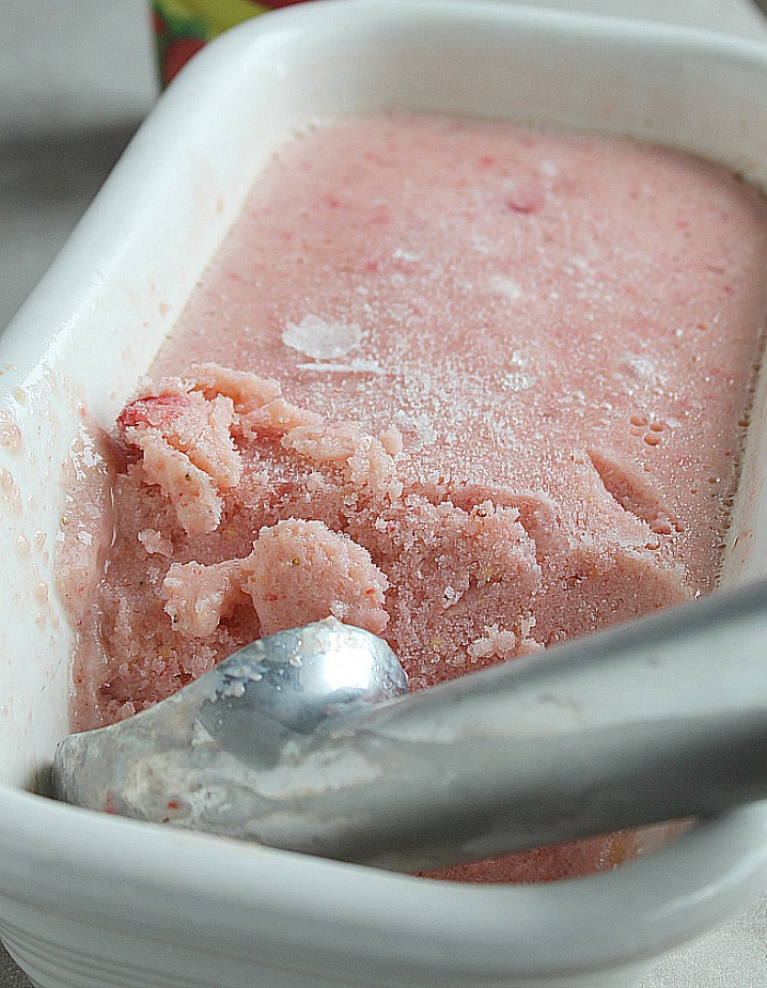 Quick and easy NO-CHURN Tropical Frozen Yogurt. Just blend up and freeze for a delish treat with strawberries, mango, pineapple and banana. YUM! via @DashOFEvans