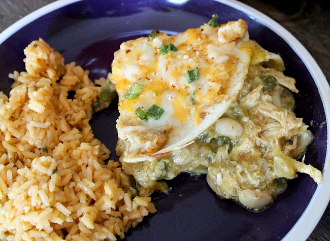 Switch up your Mexican night with an Enchilada Lasagna. Layers of white beans, tortillas and chicken mixed with a cheesy verde sauce. YUM! via @DashOfEvans & @RandallBeans