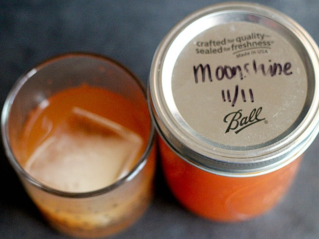 Delicous and a perfect gift: Apple Pie Moonshine. It's a great way to warm you up in the winter and SO easy to make! via @DashOfEvans