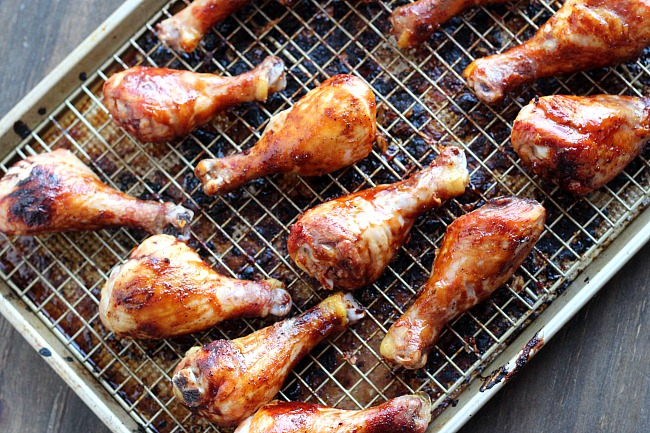 Quick and easy marinade for baked BBQ chicken legs. You'll want to try this during grilling season, too! via @DashOfEvans