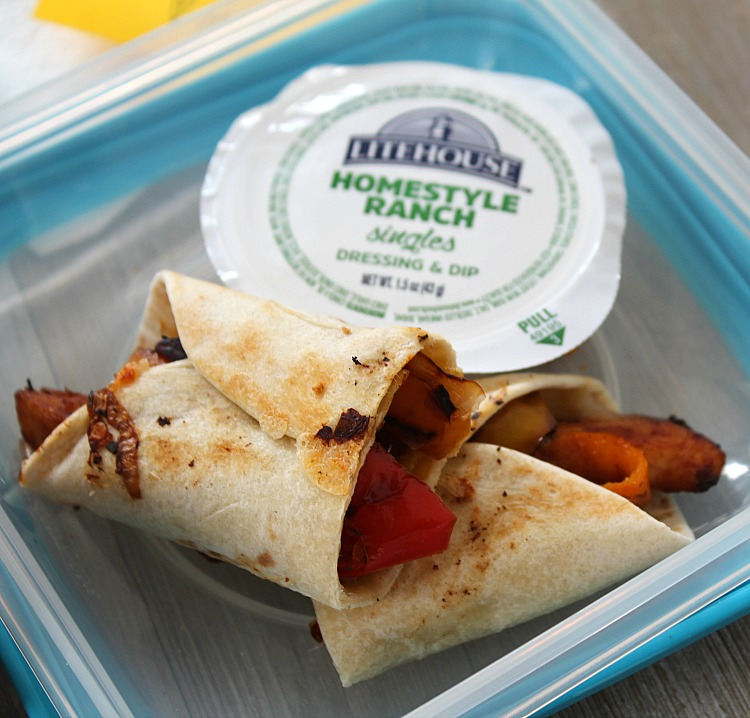 Looking for new #LunchboxIdeas? Try this Cheesy Chicken Fajita rollup with a side of ranch. The kiddos will love this fun twist on a sandwich! via @DashOfEvans #PowerYourLunchbox