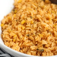 Super easy pressure cooker Mexican rice is ready in about 10 minutes and turns out fluffy. YUM! via @DashOfEvans