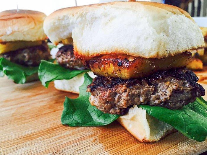 Hawaiian turkey burger sliders with King's Hawaiian rolls, lettuce, and grilled ginger pineapple