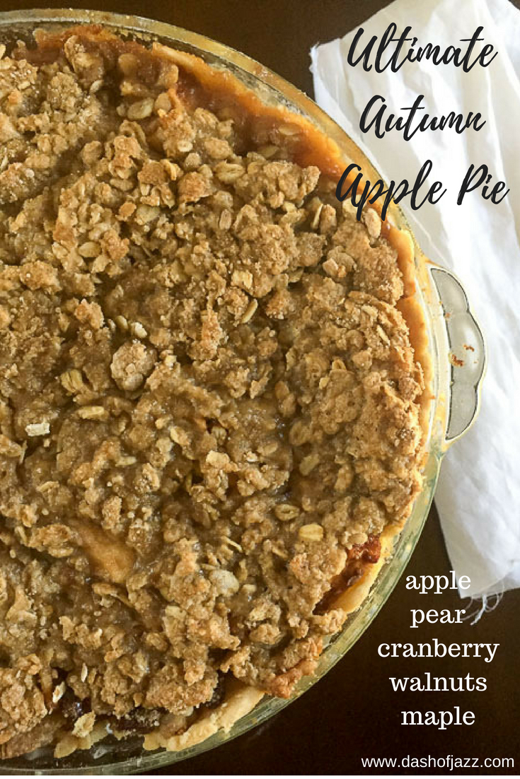 Honeycrisp apples, pears, cranberries, maple syrup, and warm spices between a flaky buttery crust and crisp oat topping = the ultimate autumn apple pie. Recipe by Dash of Jazz #dashofjazzblog #applepierecipe #applepieideas #thanksgivingdessertideas