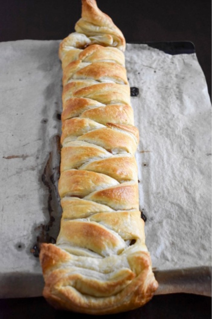 baked pastry braid stuffed with bacon, pecans, cream cheese, and sweet and spicy jam