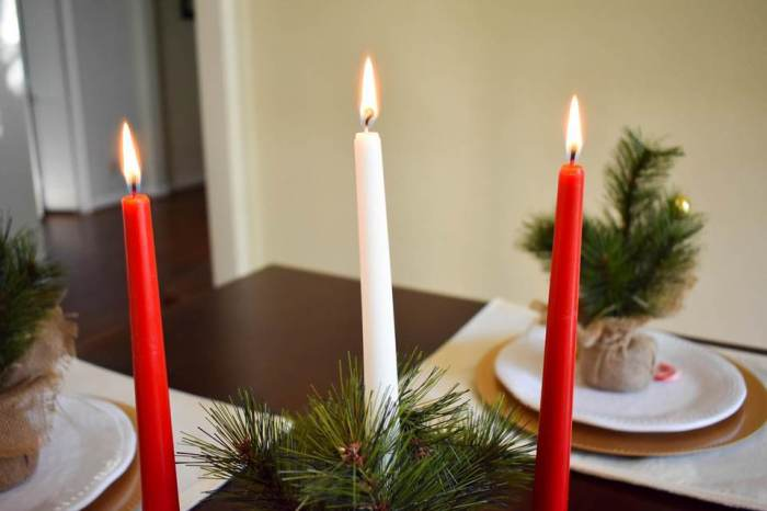 lit taper candles on Christmas table