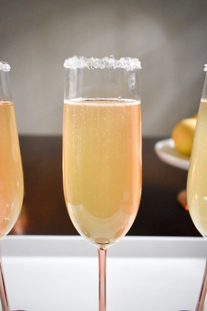 citrus champagne sparkler cocktail with sugar rim