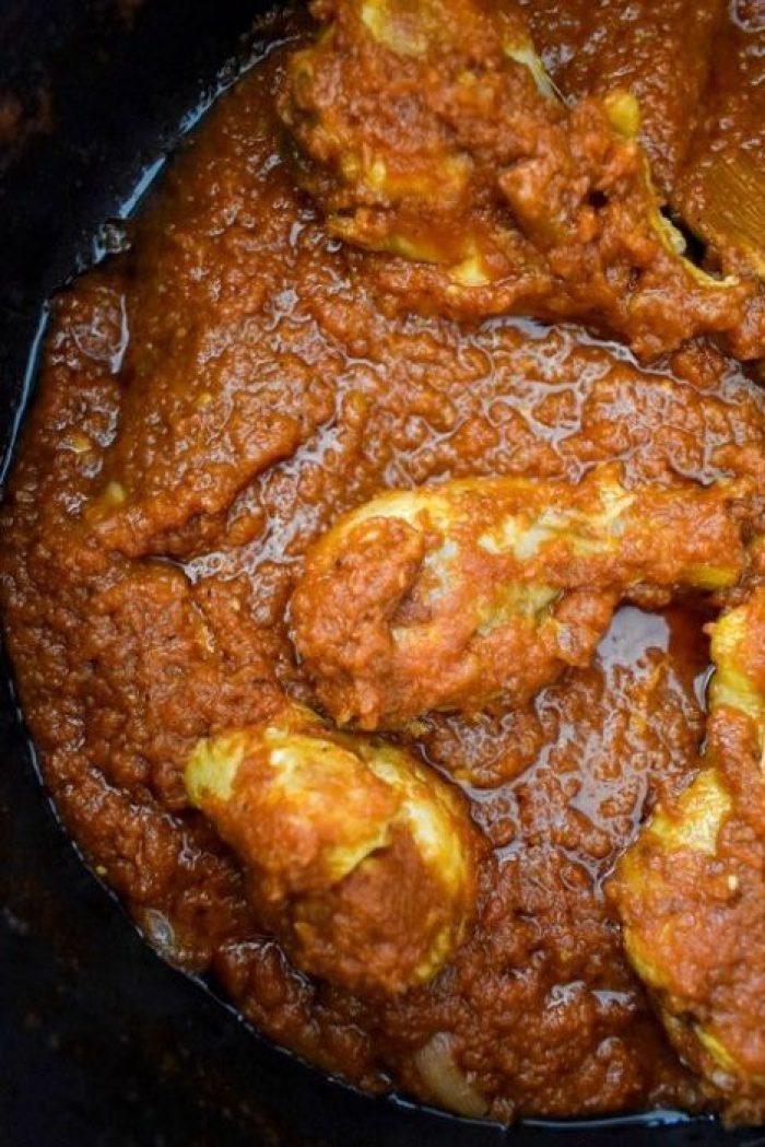 chicken and Nigerian red stew in pot