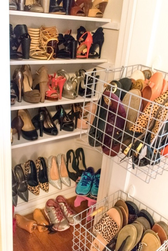 shelves and baskets of shoes in closet