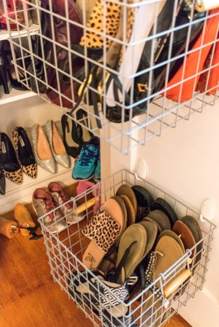 baskets holding shoes inside shoe closet