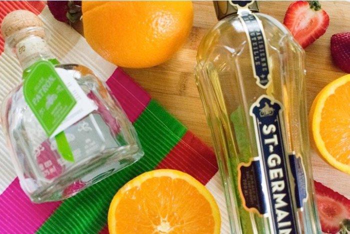 patron tequila, st germain elderflower liqueur, oranges, and strawberries