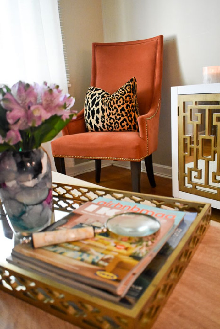"A look inside the entertaining-friendly living room of Food Blogger and Southern ""hostess with the mostest"" in her 1950s ranch-style home. Classic and modern design elements are married along with pops of color, print, and, texture, local art, and a balance of metallic and neutral furniture and accents in this living room tour seen on Dash of Jazz"
