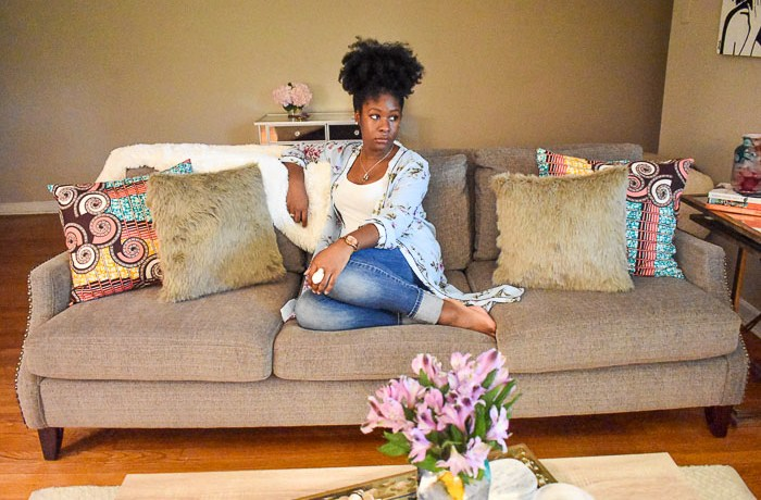 "A look inside the entertaining-friendly living room of Food Blogger and Southern ""hostess with the mostest"" Jazzmine Woodard in her 1950s ranch-style home. Classic and modern design elements are married along with pops of color, print, and, texture, local art, and a balance of metallic and neutral furniture and accents in this living room tour seen on Dash of Jazz"