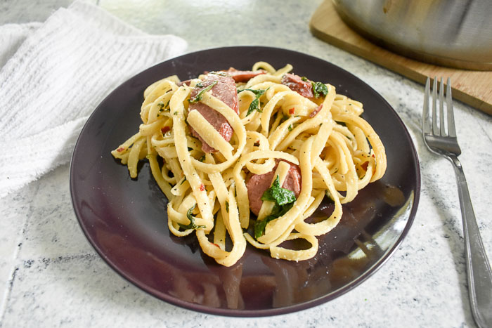 plated one-pot pasta with turkey sausage and spinach