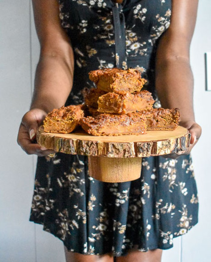 holding tray of salted caramel sweet potato blondies