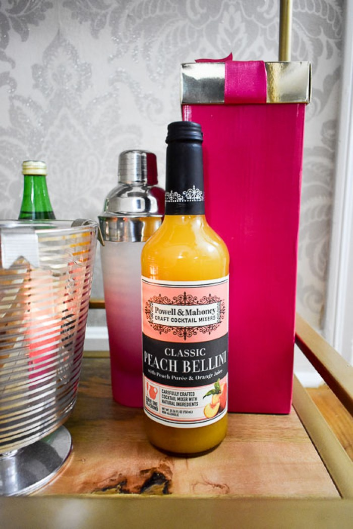 Powell & Mahoney Peach Bellini mixer is one of 6 easy bottle gift ideas for your host by Dash of Jazz.