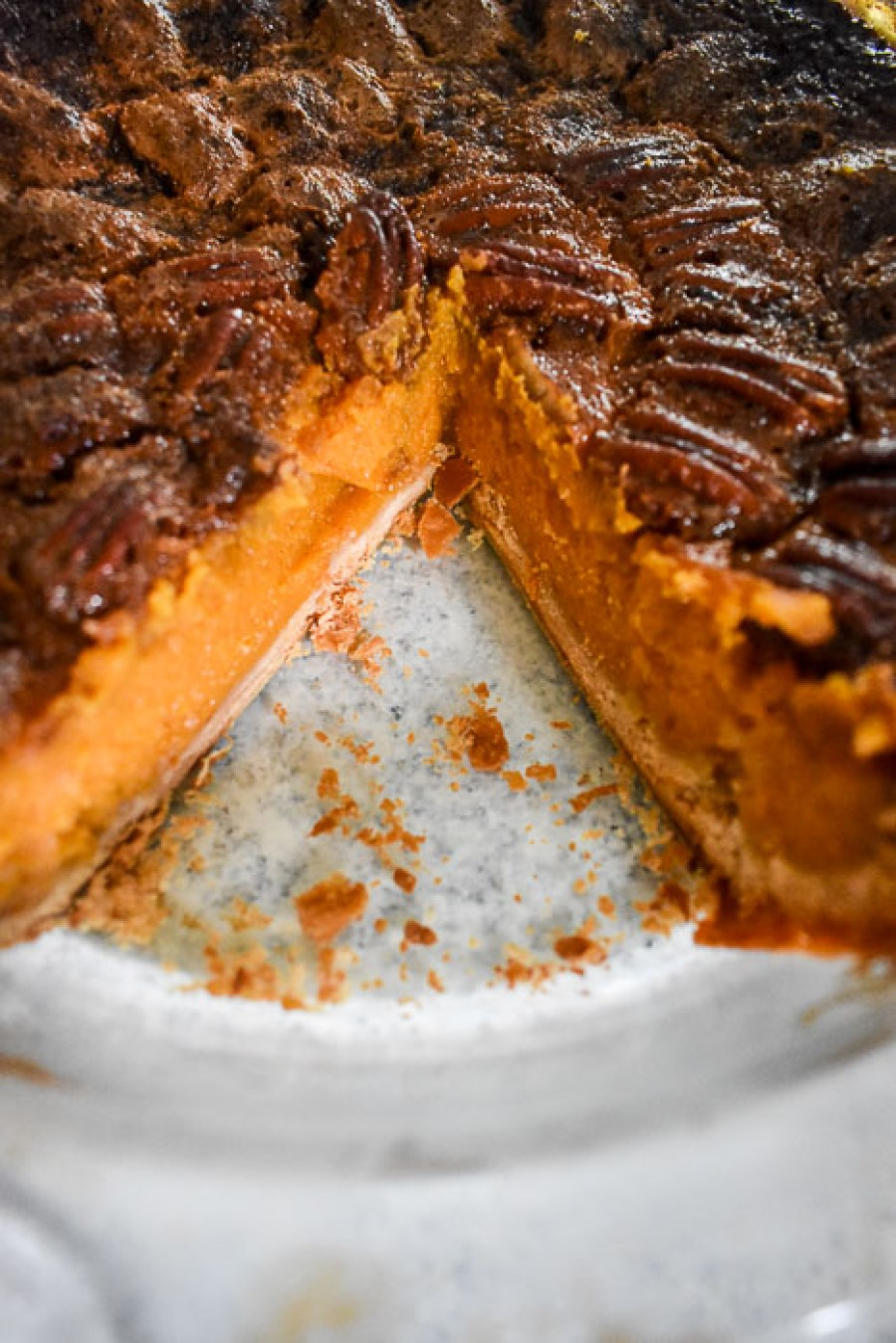 bourbon sweet potato pecan pie with slice missing