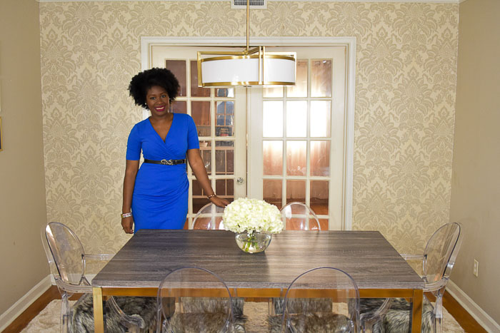 Dash of Jazz standing in completed dining room reveal space