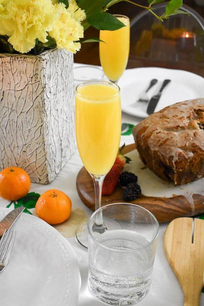 orange lavender mimosas on a springtime brunch table