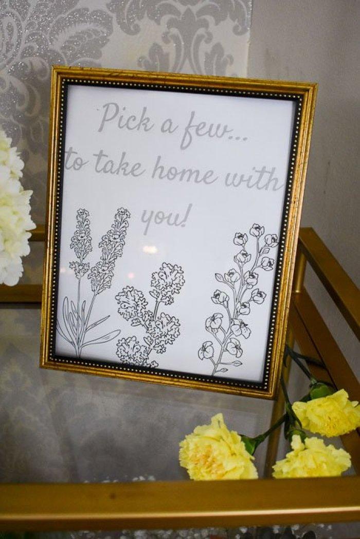 gold-framed sign