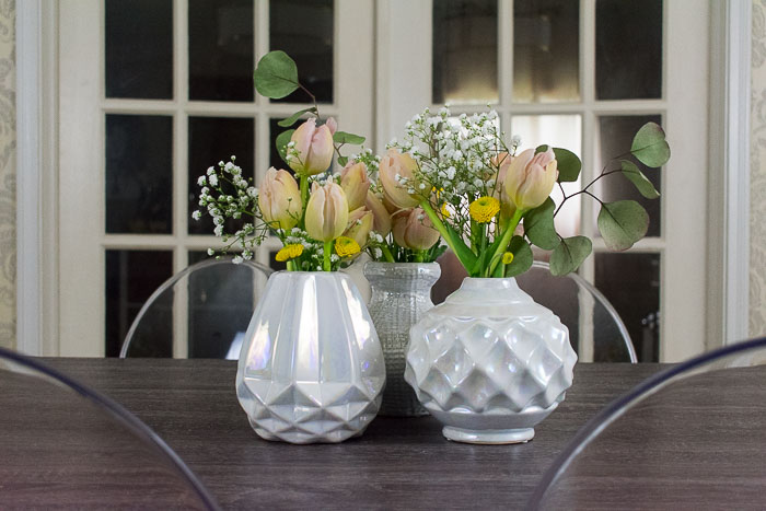 arrangements of tulips, baby's breath, and eucalyptus
