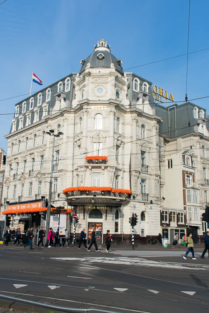 Orange balloons decorating Victoria Hotel for King's Day in Central Amsterdam