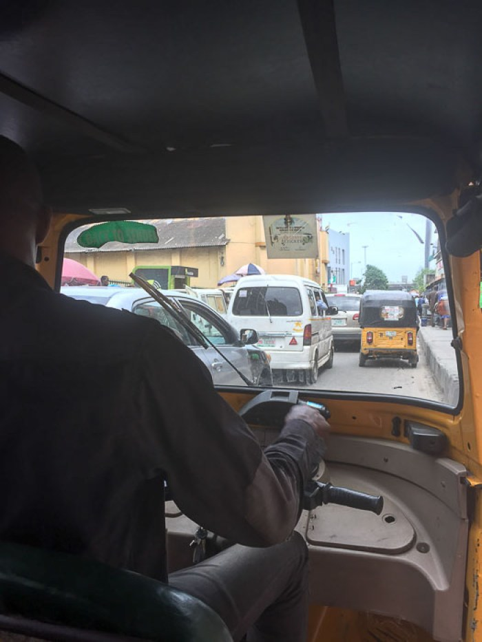 view from inside a keke in Balogun, Lagos, Nigeria