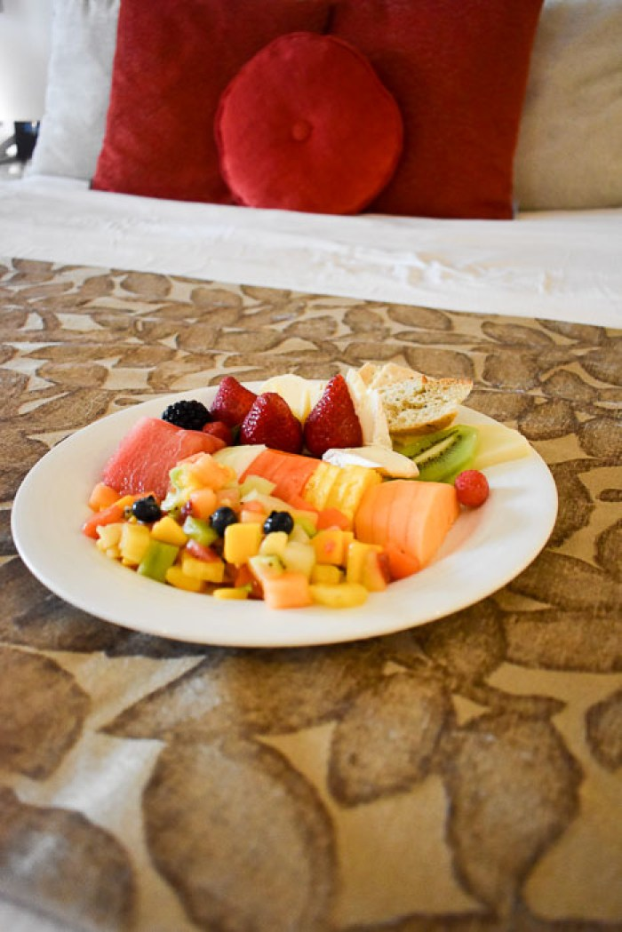 plate of fresh tropical fruits and cheses