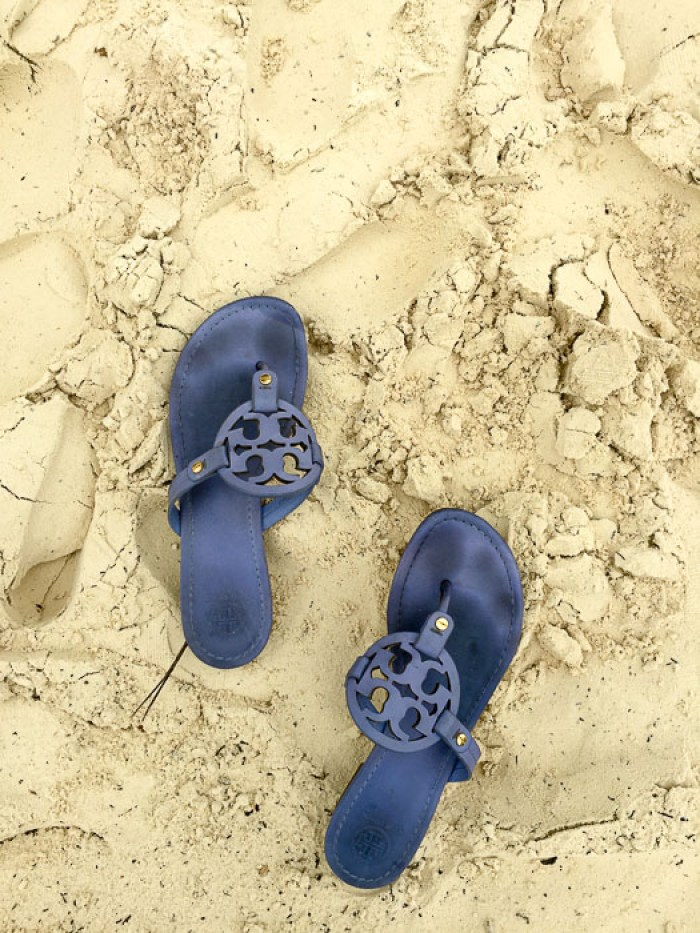 blue sandals on the beach in Cancun, Mexico