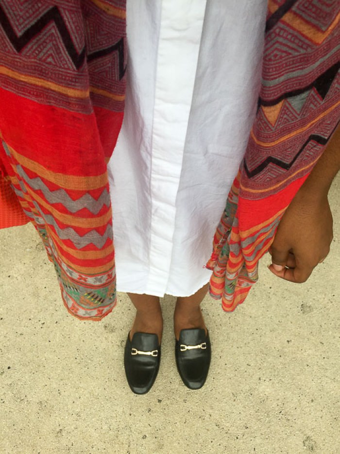 white shirt dress, multi-colored scarf, and black leather mules