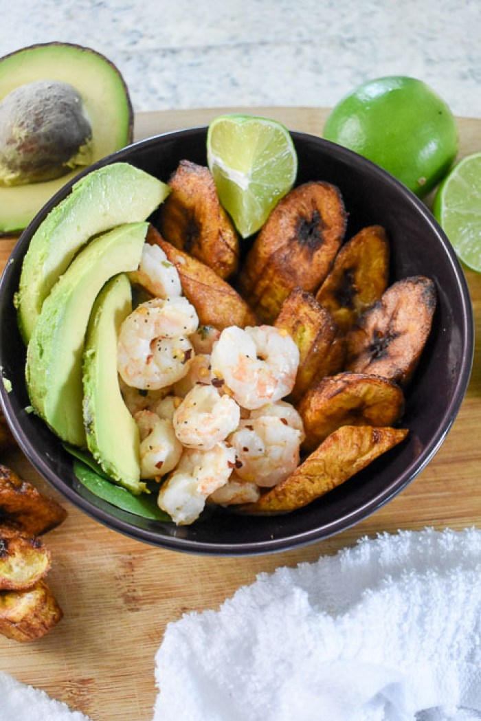 bowl of coconut lime shrimp and fried plantain