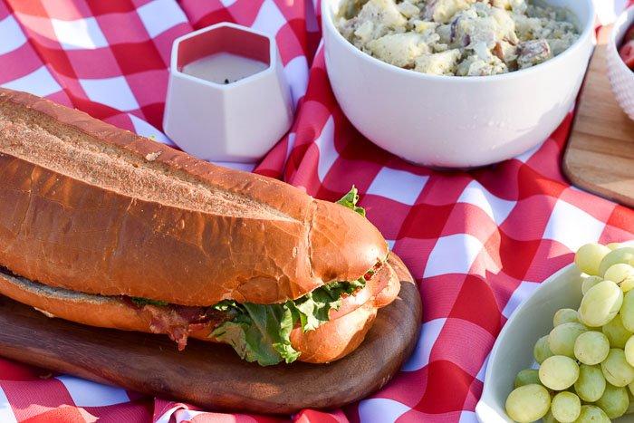 BLT sub sandwich in picnic spread