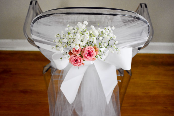 bridal shower chair adorned with baby's breath and spray roses