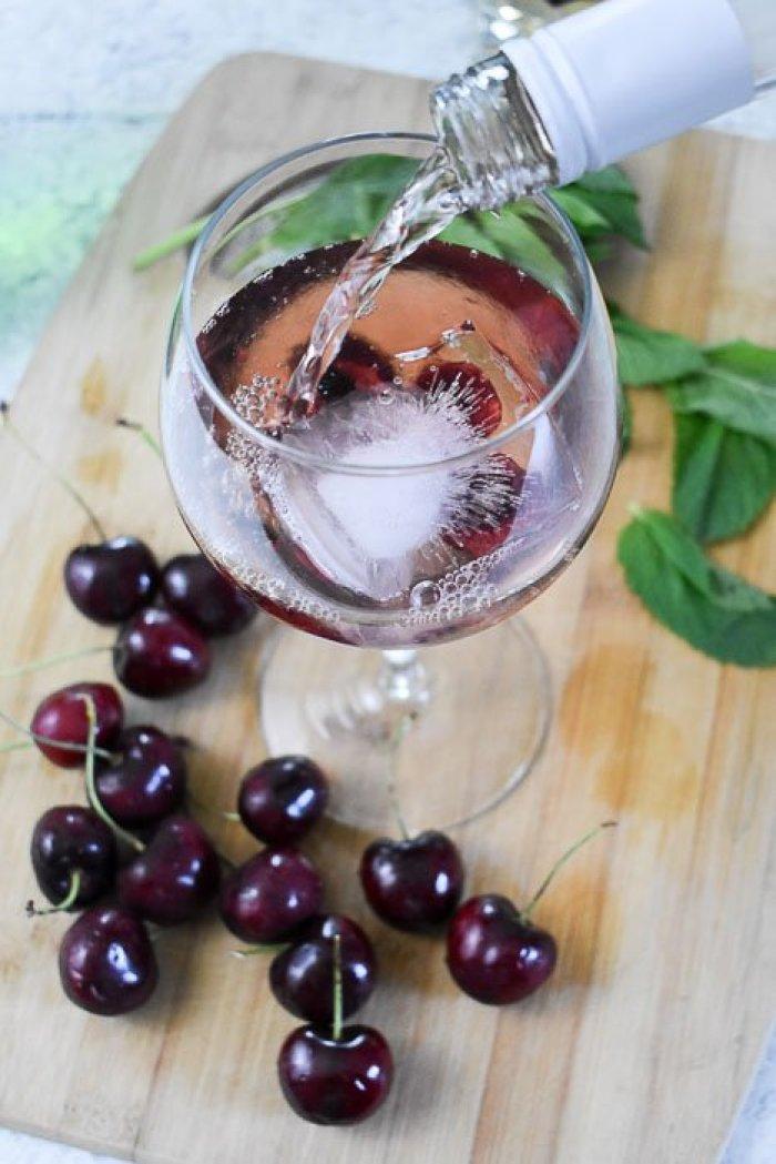 pouring rosé into spritzer cocktail