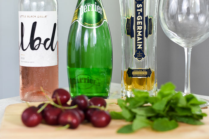 lbd rosé, perrier sparkling water, and st germain elderflower liqueur bottles